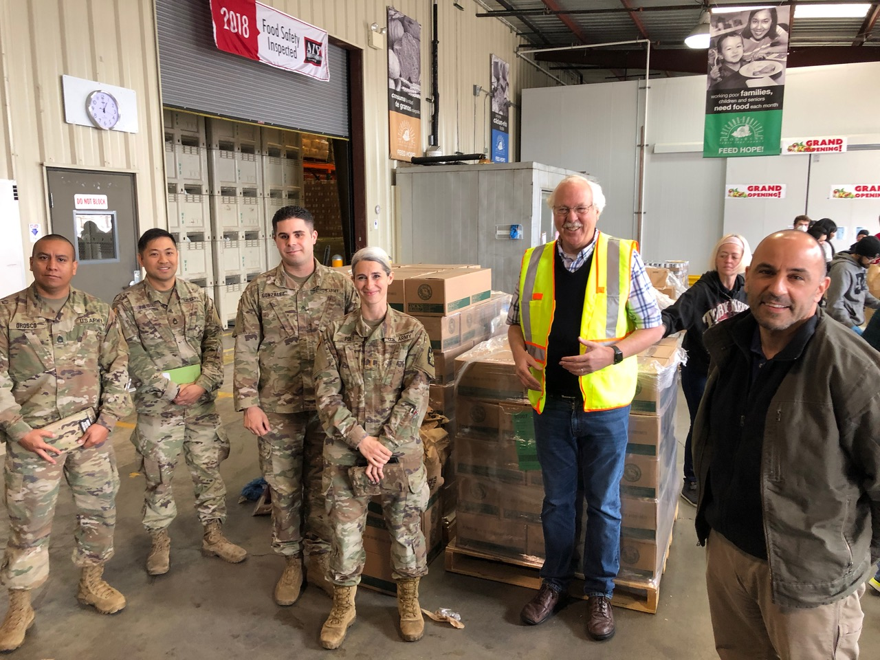 Willy Elliot-McCrea, CEO of the Second Harvest Food Bank in Santa Cruz County, with the National Guard
