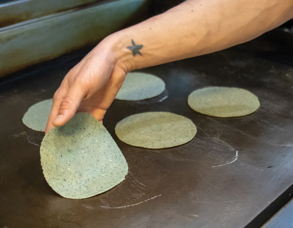 Tortillas on the griddle.