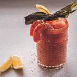 Caesar cocktail with seaweed vodka and prawn