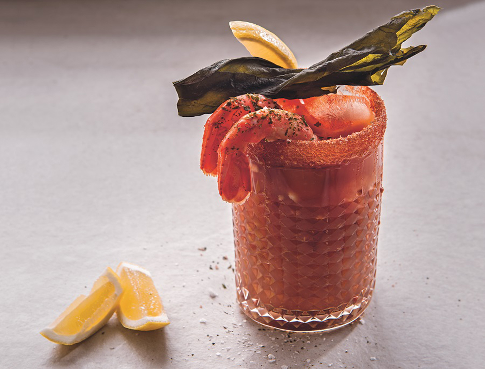 Caesar cocktail with seaweed vodka and prawn