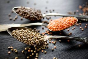 lentils in spoons on a table