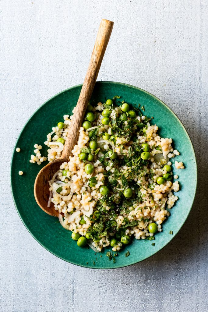 pearl cous cous and pea salad in bowl
