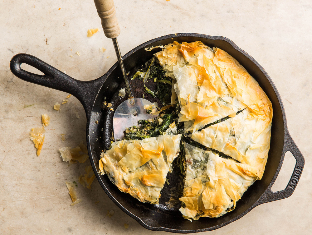 Spanakopita baked on a cast iron skillet