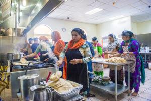 Saptal Kaur Kaleka prepares roti for langar