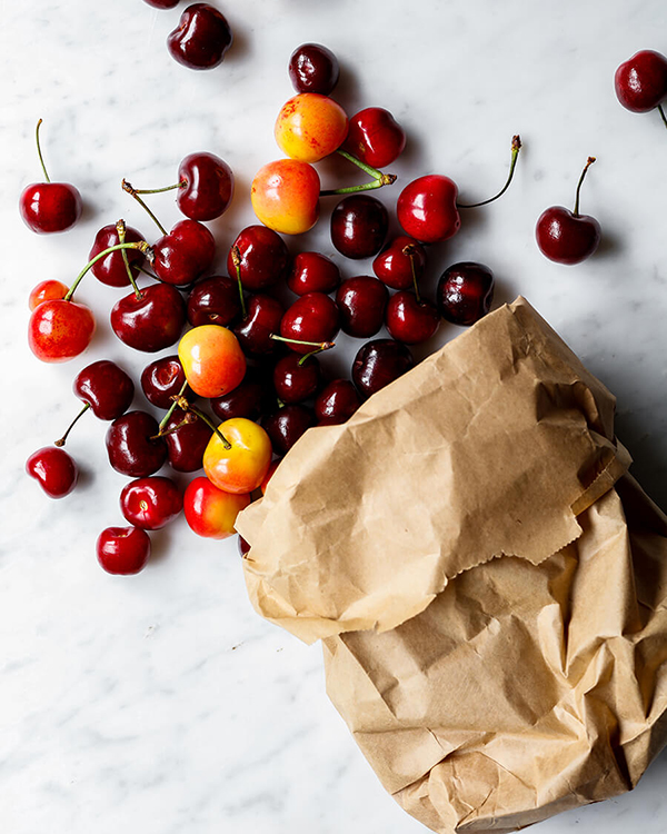 bag of red and yellow cherries