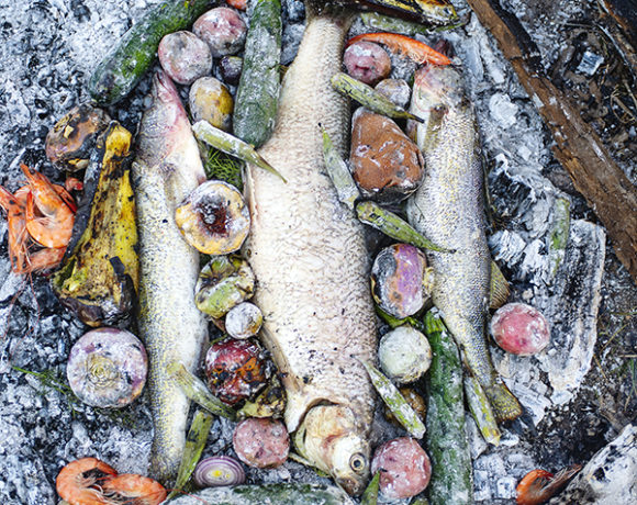 whole fish cooking in hot coals