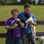 Elaine and Howard Dustin with lambs