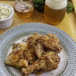fried chicken on a plate with beer