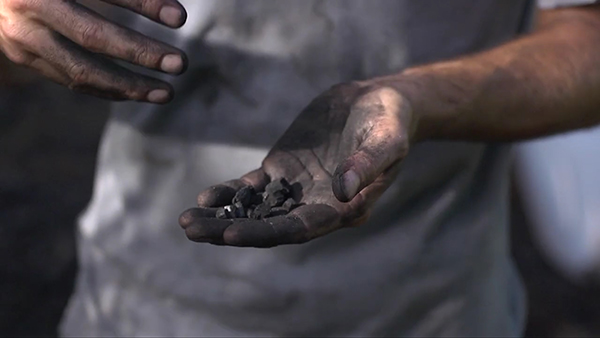 hand with charcoal