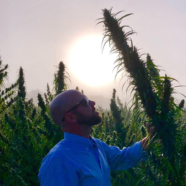 Jason Victoria with hemp plant