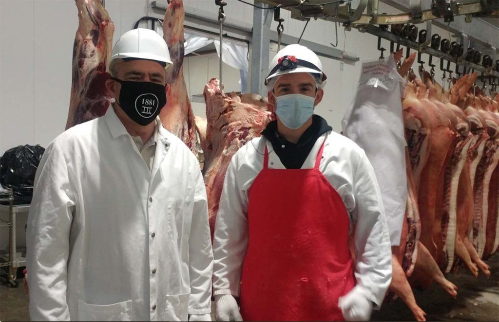 Mike Callicrate and Luis Guerra at Ranch Foods Direct carcass cooler in Colorado Springs.